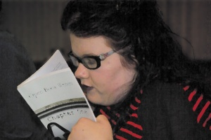 Georgina reading the first anthology